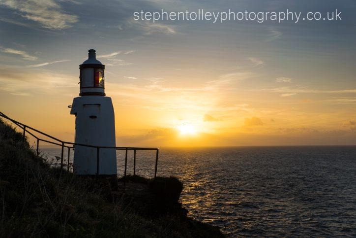Polperro lighthouse at sunrise